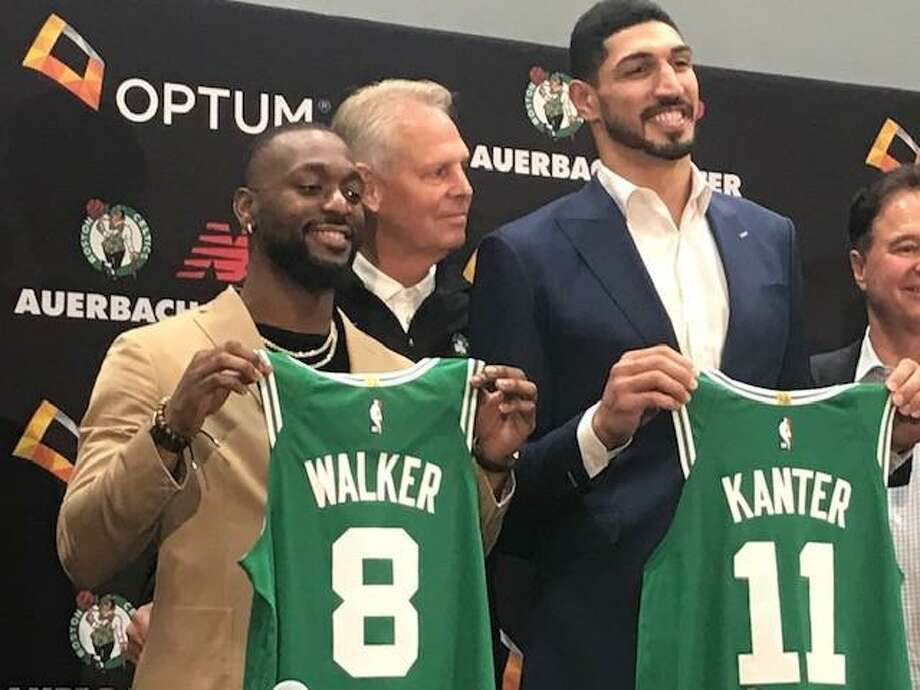 Former UConn star Kemba Walker, left, poses with Celtics GM Danny Ainge and new Celtics teammate Enes Kanter at introductory press conference on Wednesday. Photo: David Borges / Hearst Connecticut Media