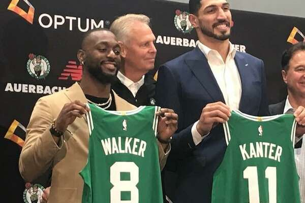 Former UConn star Kemba Walker, left, poses with Celtics GM Danny Ainge and new Celtics teammate Enes Kanter at introductory press conference on Wednesday.