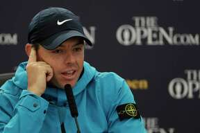 Northern Ireland's Rory McIlroy answers a question from the media at a press conference ahead of the start of the British Open golf championships at Royal Portrush in Northern Ireland, Wednesday.