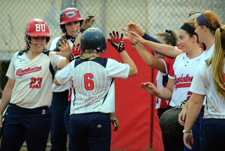 Brakettes' Denise Denis (6) is greeted with high fives at home plate after hitting a home run during softball action against Cheshire in Stratford, Conn., on Thursday July 11, 2019. Denis, will retire this year and end up near top of most offensive categories. Photo: Christian Abraham / Hearst Connecticut Media / Connecticut Post