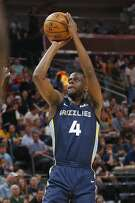 Memphis Grizzlies' Julian Washburn (4) shoots against the Utah Jazz during the first half of an NBA summer league basketball game Monday, July 1, 2019, in Salt Lake City. (AP Photo/Rick Bowmer)