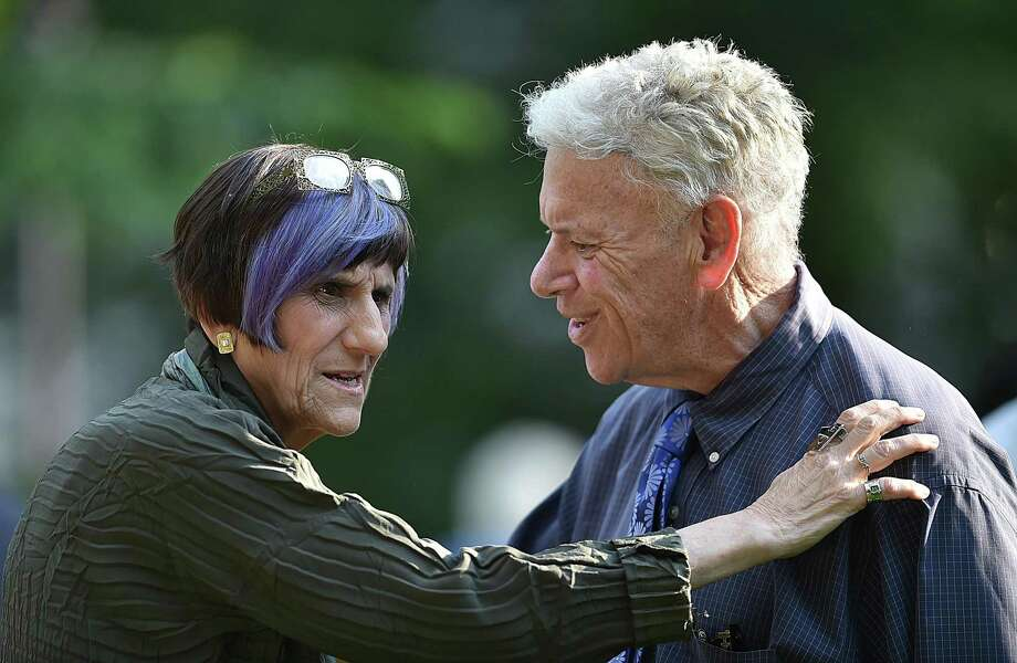 "U.S. Representative Rosa DeLauro speaks with Andy Wolf, director of Arts, Culture and Tourism at the opening of ""WE ARE: A Nation of Immigrants — New Haven"" by photographer Joe Standart, Friday, June 8 on the New Haven Green. Photo: Catherine Avalone / Hearst Connecticut Media / New Haven Register"