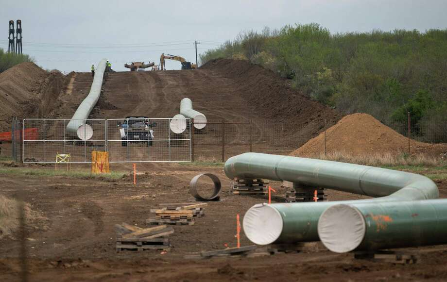 (FILES) In this file photo taken on March 12, 2019 the Double Eagle Pipeline is built just outside Cotulla, Texas, for future transport of crude oil from the Eagle Ford basin to the port of Corpus Christi. - A key US inflation measure dropped sharply in January due to plunging energy costs, the Commerce Department reported on March 29, 2019. The cost for energy goods and services fell 6.4 percent at the start of the year, compared to January 2018, dragging the Federal Reserve's preferred inflation index down to 1.4 percent year-over-year, four tenths lower than the December rate. (Photo by Loren ELLIOTT / AFP)LOREN ELLIOTT/AFP/Getty Images Photo: LOREN ELLIOTT, Contributor / AFP/Getty Images / AFP or licensors