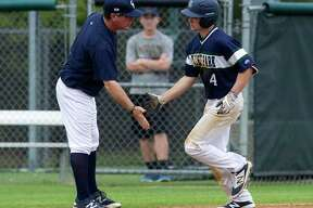 Jason Washburn, left, led College Park to the postseason 11 times as head coach.