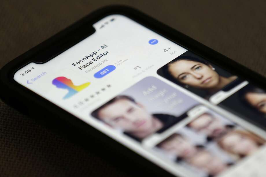 FaceApp, displayed on an iPhone, can offer users a look at their older selves by processing photos in the cloud. It has raised questions about privacy. Photo: Jenny Kane / Associated Press