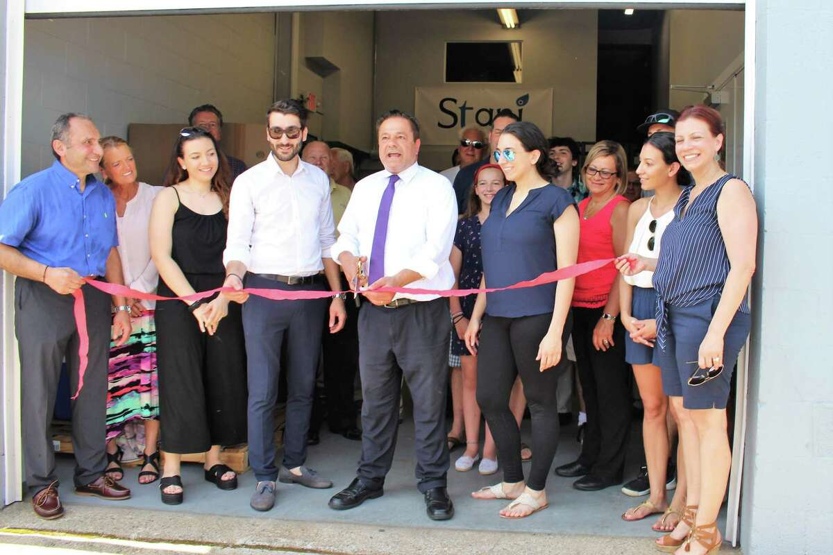 Ansonia held a ribbon-cutting ceremony Wednesday to officially welcome Stani Dairy and its line of Greek yogurt to the city.