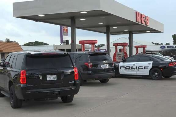 Cleveland and Montgomery County authorities investigate a deadly shooting Wednesday afternoon in a shopping center anchored by a H-E-B supermarket.