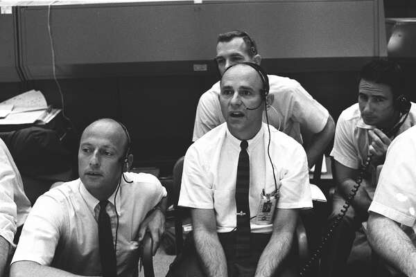 Four members of the prime and backup crews for Apollo 12 monitor activity of the first moon landing mission on July 20, 1969 from consoles in the Mission Control Center in Houston. Left to right are astronauts Charles Conrad Jr., Alan L. Bean, David R. Scott and James B. Irwin. Astronauts Neil Armstrong and Buzz Aldrin had already landed on the moon when the photo was taken. (NASA)