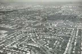 05/1964 - aerial of Pasadena, Texas - tall building in middle of photo is First Pasadena State Bank, 1001 East Southmore. HOUCHRON CAPTION (05/24/1964): FROM THE AIR the peeling paint of Pasadena's old downtown section disappears.