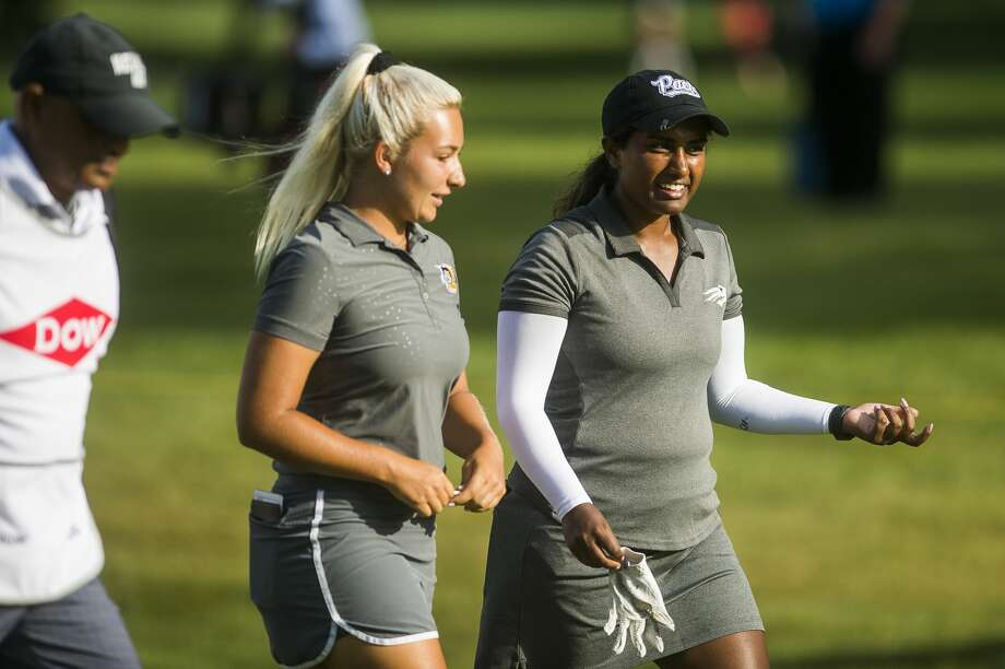 Elayna Bowser of Dearborn, left, and playing partner Chaithra Katamneni of Midland, right,  walk down a fairway during the first round of the Dow Great Lakes Bay Invitational on Wednesday, July 17, 2019 at Midland Country Club. (Katy Kildee/kkildee@mdn.net) Photo: (Katy Kildee/kkildee@mdn.net)