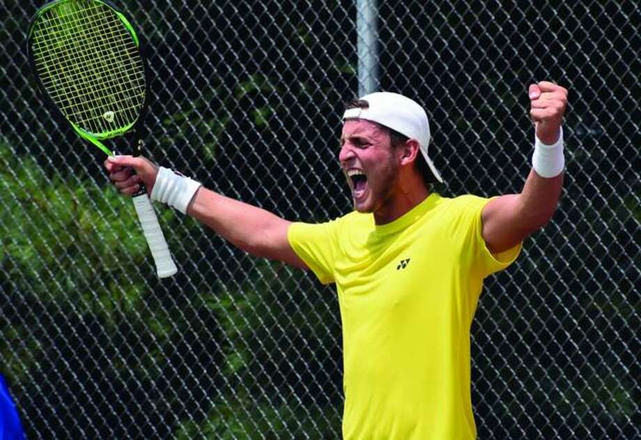 Axel Geller celebrates after winning the USTA Edwardsville Futures in a three-set tiebreaker on Sunday at the EHS Tennis Center. It was the first Futures championship for Geller, who is from Buenos Aires, Argentina. Photo: Matt Kamp/The Intelligencer