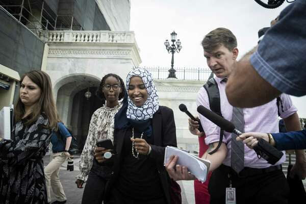 U.S. Rep. Ilhan Omara of Michigan leaves the Capitol building after voting for a resolution denouncing comments by President Donald Trump for targeting herself and three other Democratic congresswomen of color Tuesday.