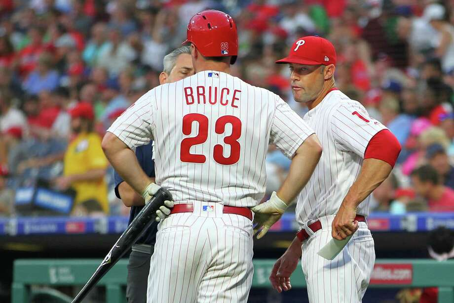 PHILADELPHIA, PA - JULY 16: Jay Bruce #23 of the Philadelphia Phillies is is looked at by a member of the medical staff and manager Gabe Kapler #19 after injuring himself on a swing against the Los Angeles Dodgers during the third inning of a baseball game at Citizens Bank Park on July 16, 2019 in Philadelphia, Pennsylvania. Bruce left the game in the middle of his at-bat. (Photo by Rich Schultz/Getty Images) Photo: Rich Schultz, Stringer / Getty Images / 2019 Getty Images