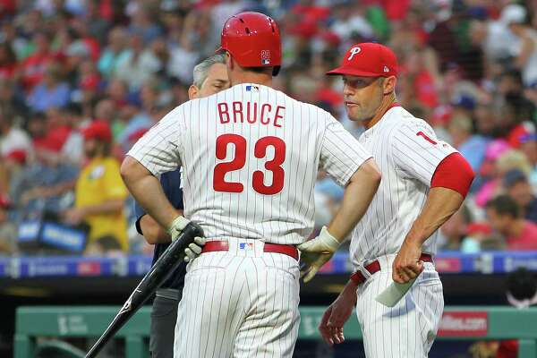 PHILADELPHIA, PA - JULY 16: Jay Bruce #23 of the Philadelphia Phillies is is looked at by a member of the medical staff and manager Gabe Kapler #19 after injuring himself on a swing against the Los Angeles Dodgers during the third inning of a baseball game at Citizens Bank Park on July 16, 2019 in Philadelphia, Pennsylvania. Bruce left the game in the middle of his at-bat. (Photo by Rich Schultz/Getty Images)