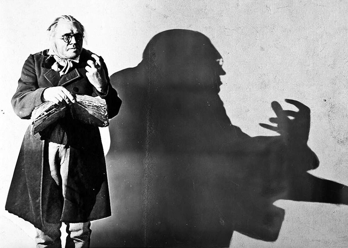 The Cabinet of Dr. Caligari (1920) - Director: Robert Wiene - IMDb user rating: 8.1 - Votes: 49,984 - Metascore: data not available - Runtime: 67 min This heralded silent film brims with bizarre visuals and is considered the most quintessential example of German expressionism. Its themes of madness and mayhem are reinforced by over-stylized set pieces and creepy characters. According to critic Roger Ebert, the movie's uniquely twisted world-building helped make it the