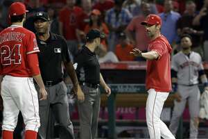 Los Angeles Angels manager Brad Ausmus right, gestures to pitcher Noe Ramirez (24) after Ramirez hit Houston Astros' Jake Marisnick with a pitch during the sixth inning of a baseball game Tuesday, July 16, 2019, in Anaheim, Calif. (AP Photo/Marcio Jose Sanchez)