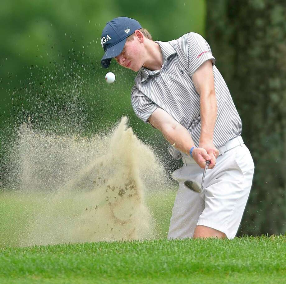 Tyler Sudell hits out of the sand trap at the ninth hole in the Greenwich Town Junior Golf Championship at the Griffith E. Harris Golf Center in Greenwich, Conn. on July 17, 2019. Sudell won his age group division with a score of 78. Photo: Matthew Brown / Hearst Connecticut Media / Stamford Advocate