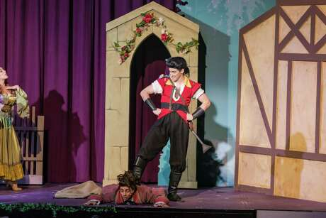 """Cary Farrow IV and Michael Parisi play Gaston and Lefou in the Woodlawn Theatre's staging of """"Beauty and the Beast."""" The roles are physically challening for both actors."""