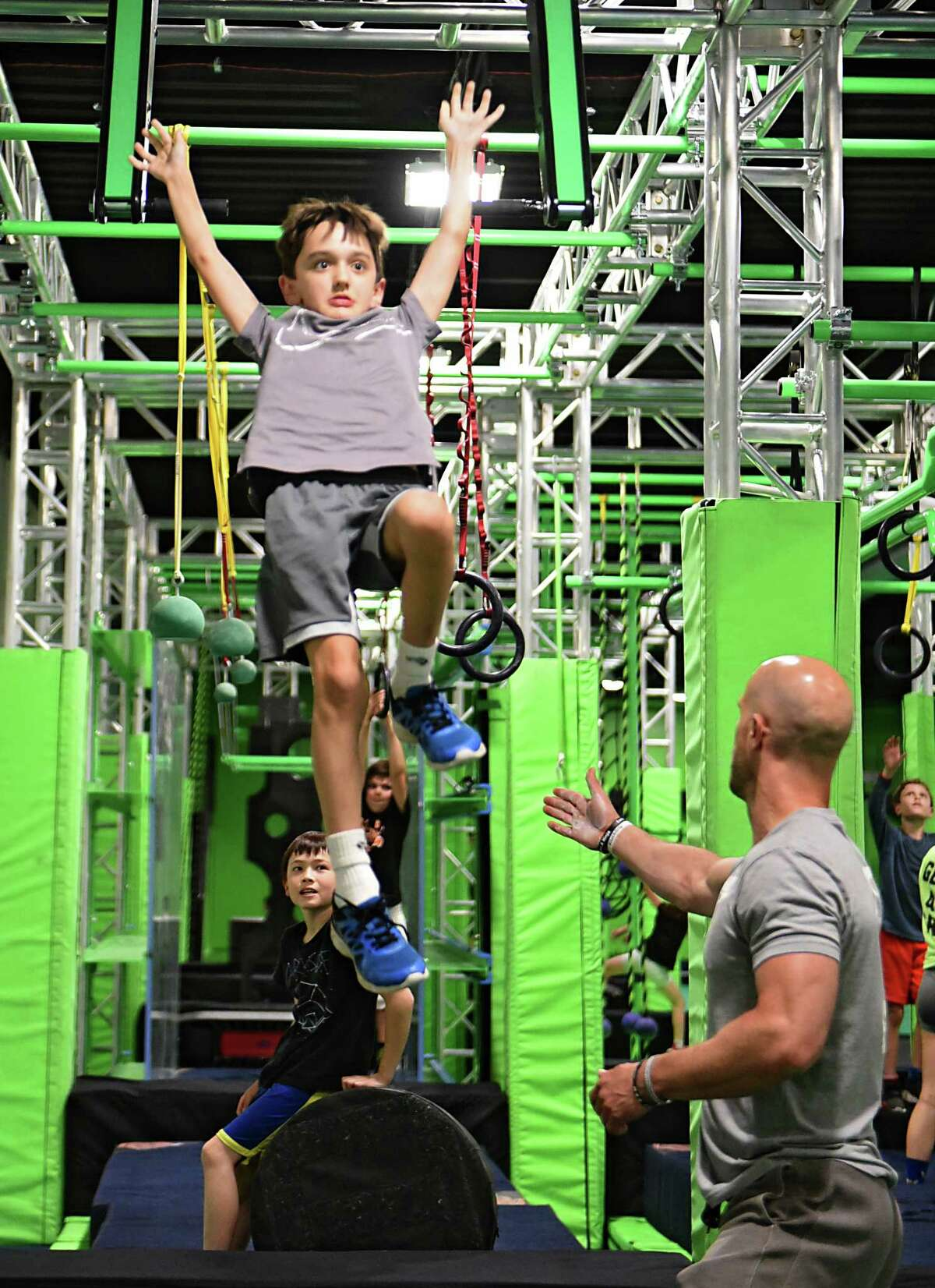 Co-owner and ninja coach Geoff Snyder, right, helps Christopher, 9, of Albany practice on the ninja course in a newly opened Ninja Lab at Crossgates Commons on Wednesday, June 19, 2019 in Guilderland, N.Y. (Lori Van Buren/Times Union)