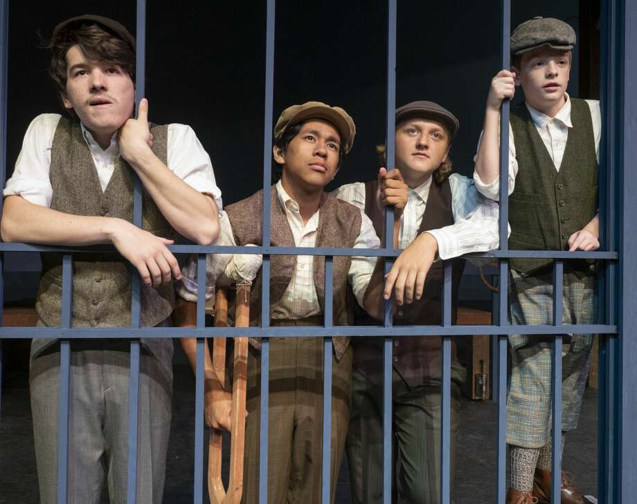 Jonah Thacher as Jack, Gabriel Almanger as Crutchie, Jake Englestad as Davey and Blane Wheeless as Les are locked out from getting their newspapers in The Pickwicks production of Newsies. 07/03/19  Tim Fischer/Reporter-Telegram Photo: Tim Fischer/Midland Reporter-Telegram