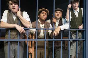 Jonah Thacher as Jack, Gabriel Almanger as Crutchie, Jake Englestad as Davey and Blane Wheeless as Les are locked out from getting their newspapers in The Pickwicks production of Newsies. 07/03/19  Tim Fischer/Reporter-Telegram