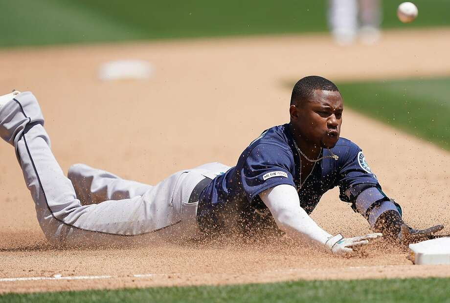 OAKLAND, CA - JULY 17:  Tim Beckham #1 of the Seattle Mariners dives into third base with a triple against the Oakland Athletics in the top of the six inning at Ring Central Coliseum on July 17, 2019 in Oakland, California.  (Photo by Thearon W. Henderson/Getty Images) Photo: Thearon W. Henderson, Getty Images