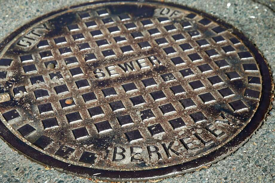 """A manhole cover at Piedmont Street and Garber Avenue in Berkeley, Calif. on Wednesday, July 17, 2019. The Berkeley City Council passed an ordinance to replace gendered language in the city's municipal code with neutral terms, so these would no longer be referred to as """"manhole"""" covers. Photo: Paul Chinn, The Chronicle"""