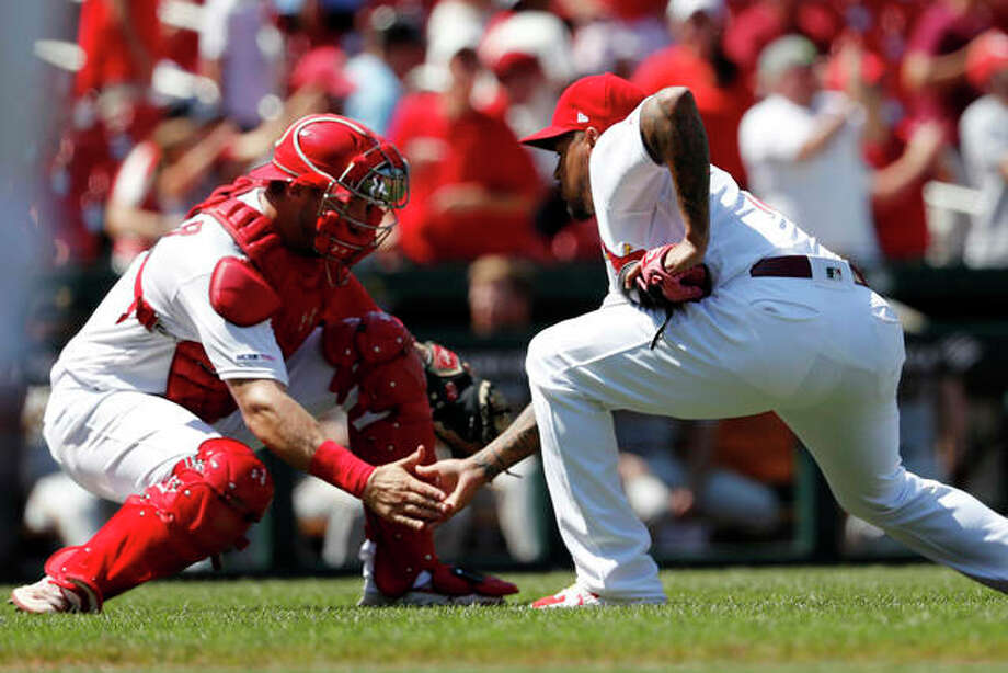 Cardinals closer Carlos Martinez (right) and catcher Andrew Knizner celebrate the Cards' 6-5 victory over the Pittsburgh Pirates on Wednesday afternoon in St. Louis. Photo: Associated Press