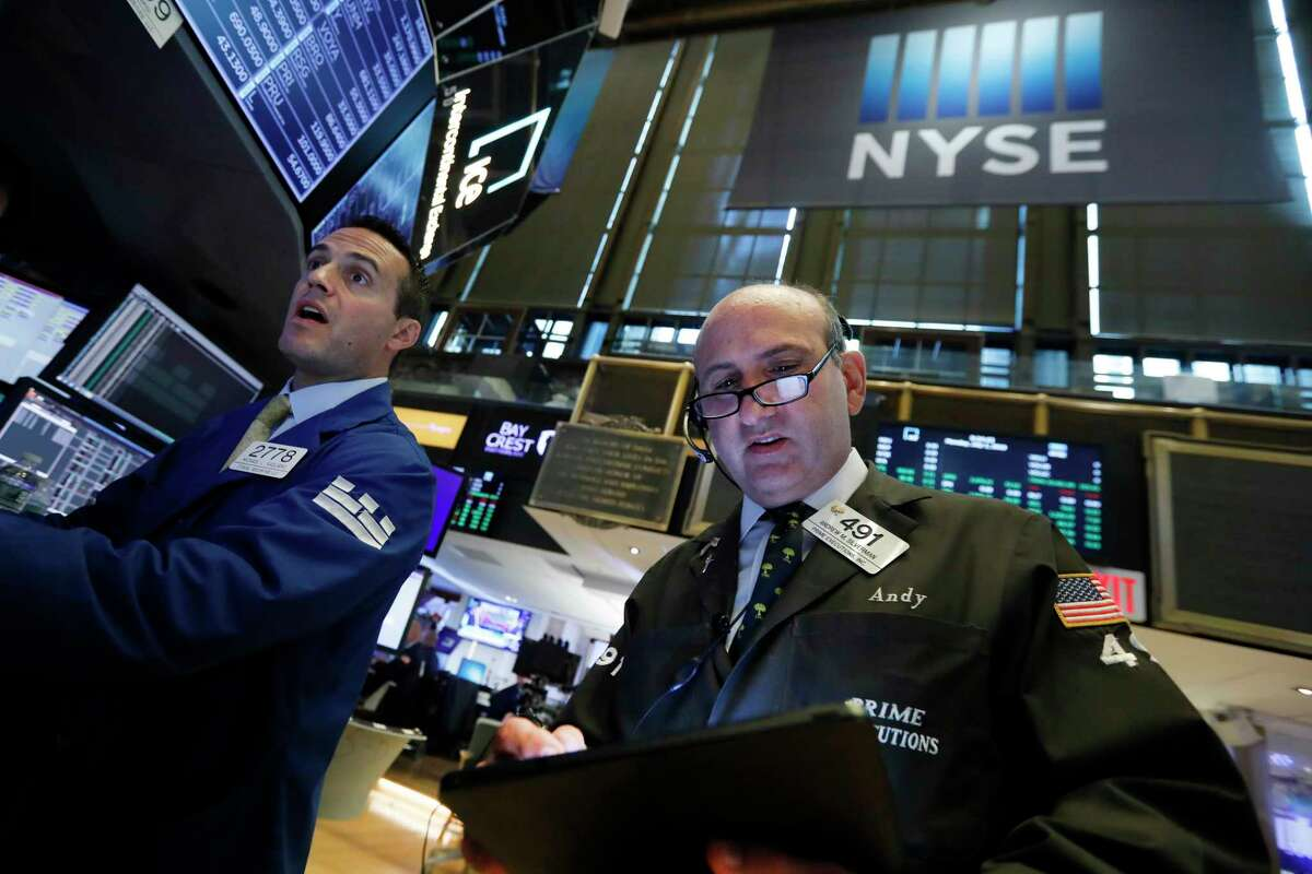 FILE- In this July 1, 2019, file photo specialist Michael Gagliano, left, and trader Andrew Silverman work on the floor of the New York Stock Exchange. The U.S. stock market opens at 9:30 a.m. EDT on Wednesday, July 17. (AP Photo/Richard Drew, File)