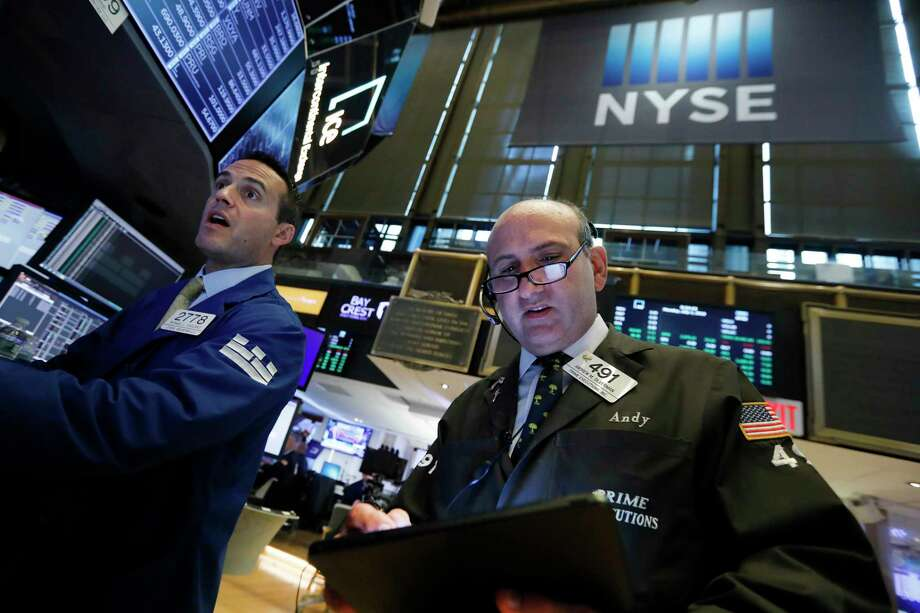 FILE- In this July 1, 2019, file photo specialist Michael Gagliano, left, and trader Andrew Silverman work on the floor of the New York Stock Exchange. The U.S. stock market opens at 9:30 a.m. EDT on Wednesday, July 17. (AP Photo/Richard Drew, File) Photo: Richard Drew / Copyright 2019 The Associated Press. All rights reserved.