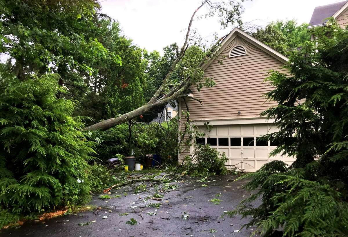 Storm damage at a home along Judd Street in Fairfield, Conn., on Wednesday July 17, 2019.