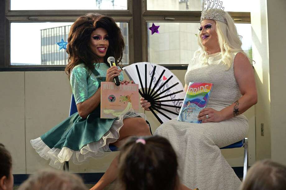 Over a hundred people attend the first Drag Queen Story Time featuring Robin Fierce and Anita Manager Wednesday, July 17, 2019, at the Norwalk Public Library Main Branch on Belden Ave. in Norwalk, Conn. Troupe429 partnered with the library to sponsor the event with snacks provided by Forever Sweet Bakery. Photo: Erik Trautmann / Hearst Connecticut Media / Norwalk Hour