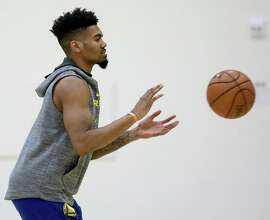Warriors' Jacob Evans III is transitioning back to the point guard position.