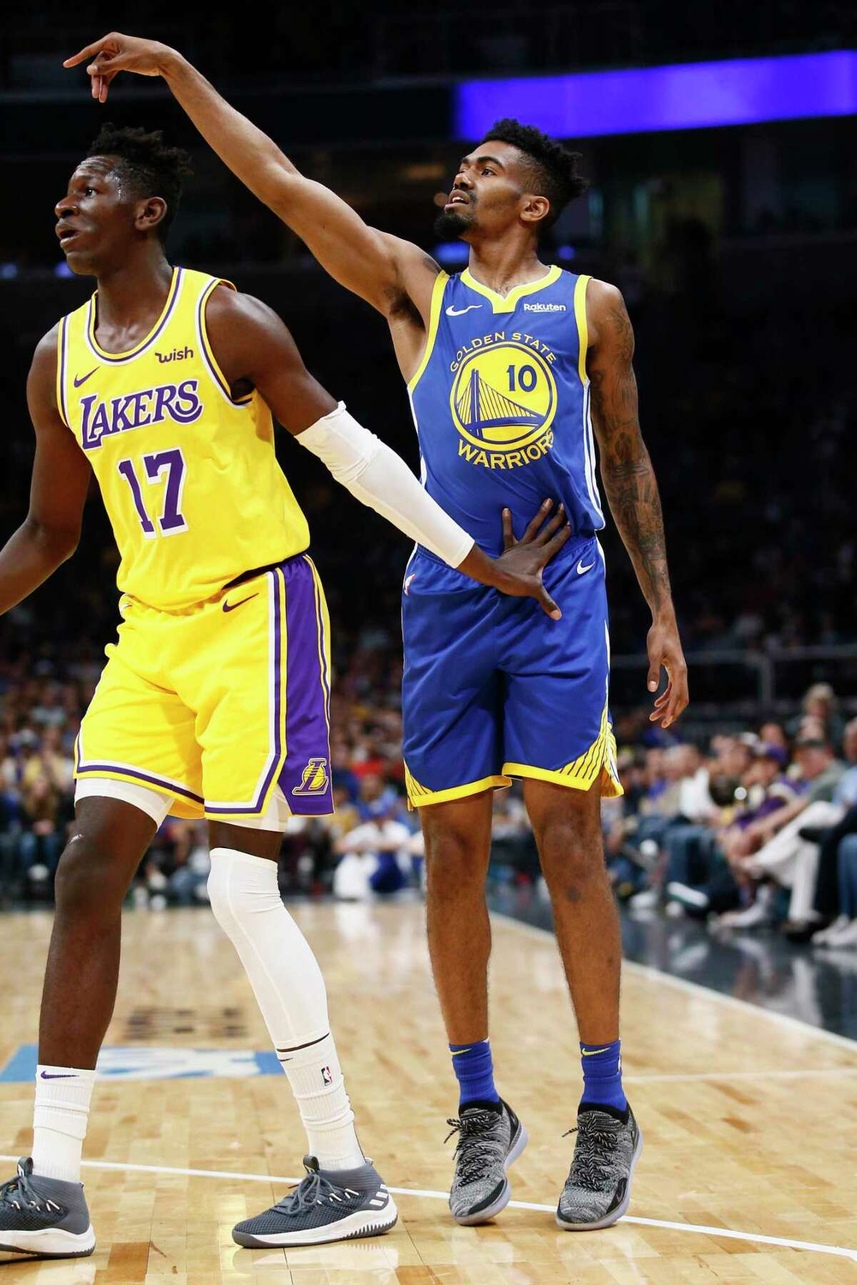 Golden State Warriors guard Jacob Evans III shoots against Los Angeles Lakers guard Isaac Bonga during an October game in San Jose.