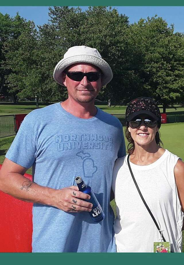 Trey Brown, left, and his wife, Jill Brown, were among many fans who attended Wednesday's first round of the Dow Great Lakes Bay Invitational at Midland Country Club. (Dan Chalk/chalk@mdn.net)