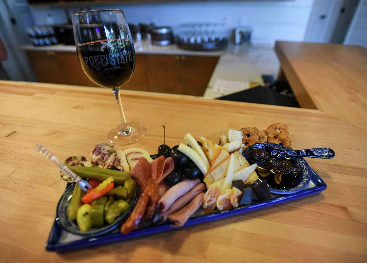 A glass of wine with a sampler of different food at Free State Cellars Winery in Orange on Wednesday afternoon. Photo taken on Wednesday, 07/10/19. Ryan Welch/The Enterprise