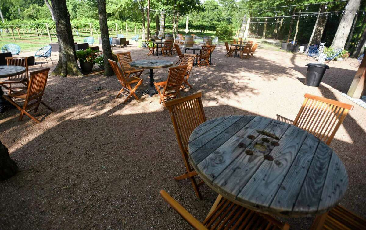 Chairs and tables fill the patio area at Free State Cellars Winery in Orange on Wednesday afternoon. Photo taken on Wednesday, 07/10/19. Ryan Welch/The Enterprise