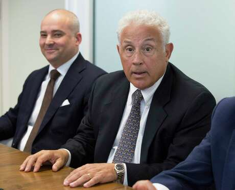 Prime Social Poker Room lawyers Joe Magliolo Jr., right, and Zack Fertitta answer questions during a press conference regarding to the poker room cases dismissed by the Harris County District Attorney's Office on Wednesday, July 17, 2019, in Houston. District Attorney Kim Ogg dismissed felony money laundering charges against nine defendants, citing a potential conflict of interest involving a former contract employee and campaign donor Tuesday. Magliolo and Fertitta said their client was trying to do everything right but was raided in May.
