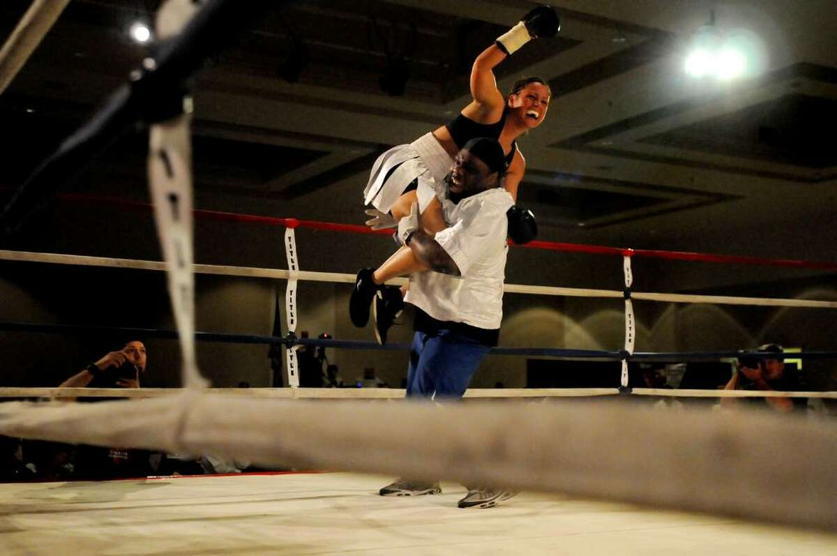 Maureen Shea of the Bronx celebrates her knock out with trainer Aroz Gist at Saratoga Springs City Center. Shea knocked out Liliana Martinez in 1:18 minutes. (Cindy Schultz / Times Union)