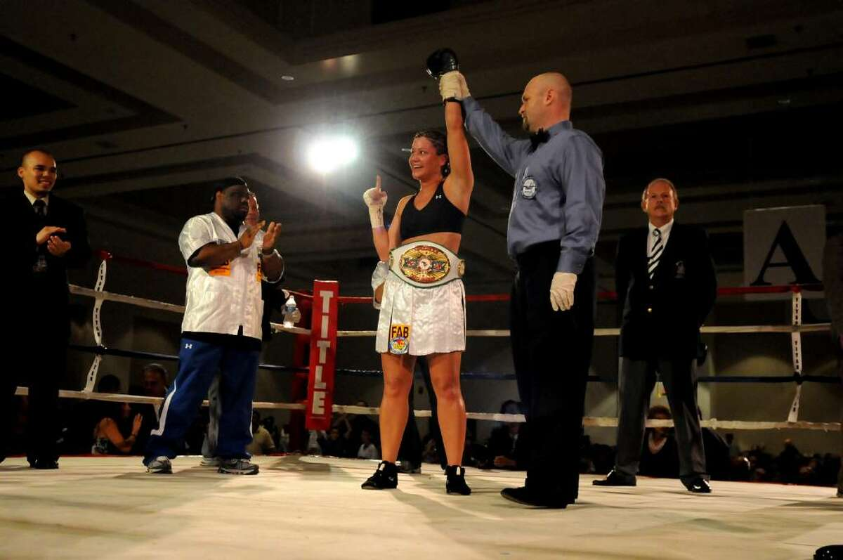 Maureen Shea of the Bronx is declared the winner after knocking out Liliana Martinez in 1:18 at Saratoga Springs City Center. (Cindy Schultz / Times Union)