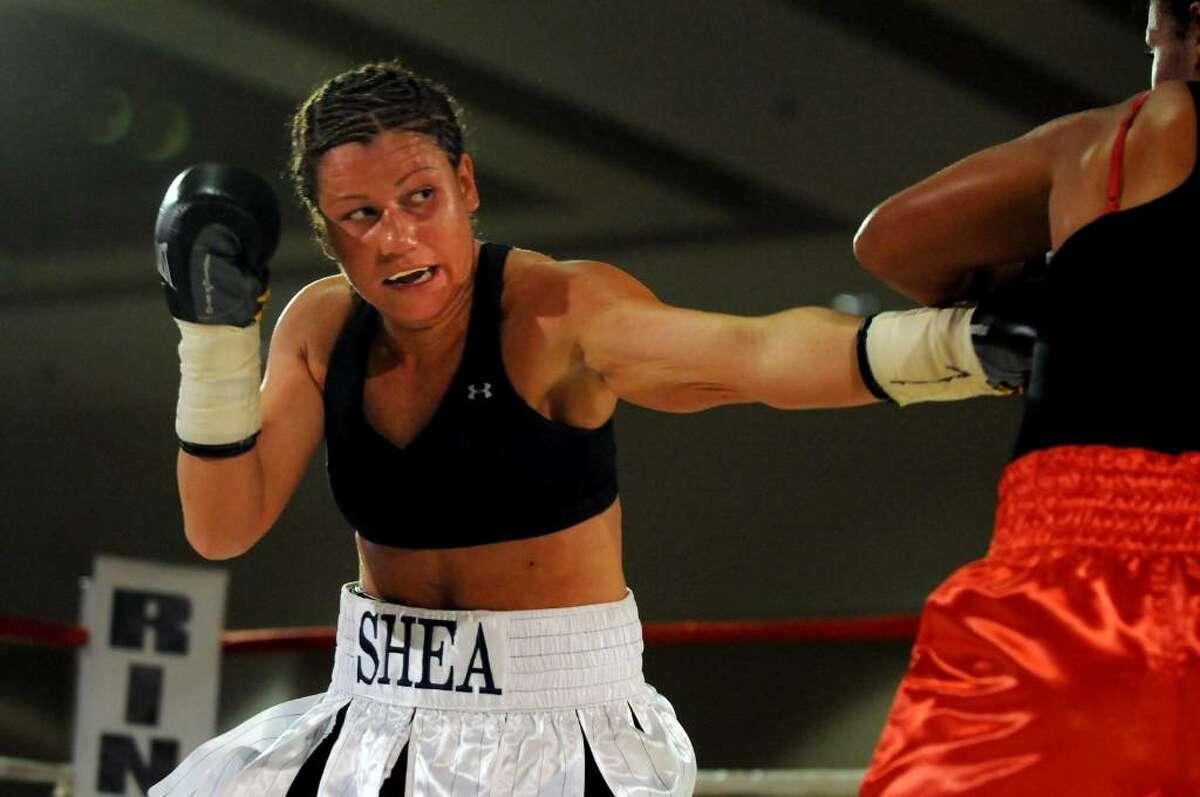 Maureen Shea of the Bronx boxes Liliana Martinez at Saratoga Springs City Center. (Cindy Schultz / Times Union)