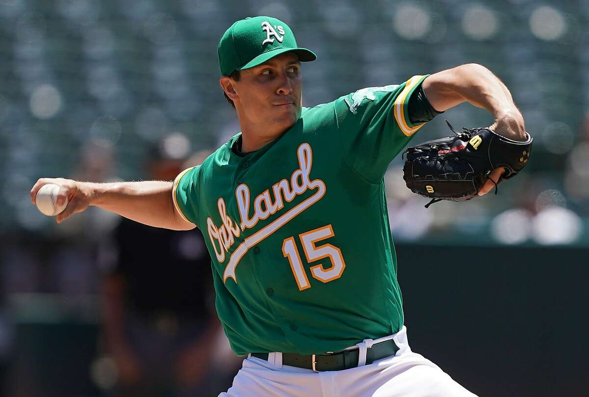 OAKLAND, CA - JULY 17: Homer Bailey #15 of the Oakland Athletics pitches against the Seattle Mariners in the top of the first inning at Ring Central Coliseum on July 17, 2019 in Oakland, California. (Photo by Thearon W. Henderson/Getty Images)
