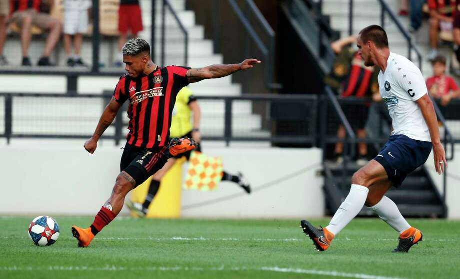 Atlanta United forward Josef Martinez (7) takes a shot as Saint Louis FC defender Sam Fink (4) defends during the first half of a U.S. Open Cup Quarterfinal soccer match Wednesday, July 10, 2019, in Kennesaw, Ga. (AP Photo/John Bazemore) / Copyright 2019 The Associated Press. All rights reserved