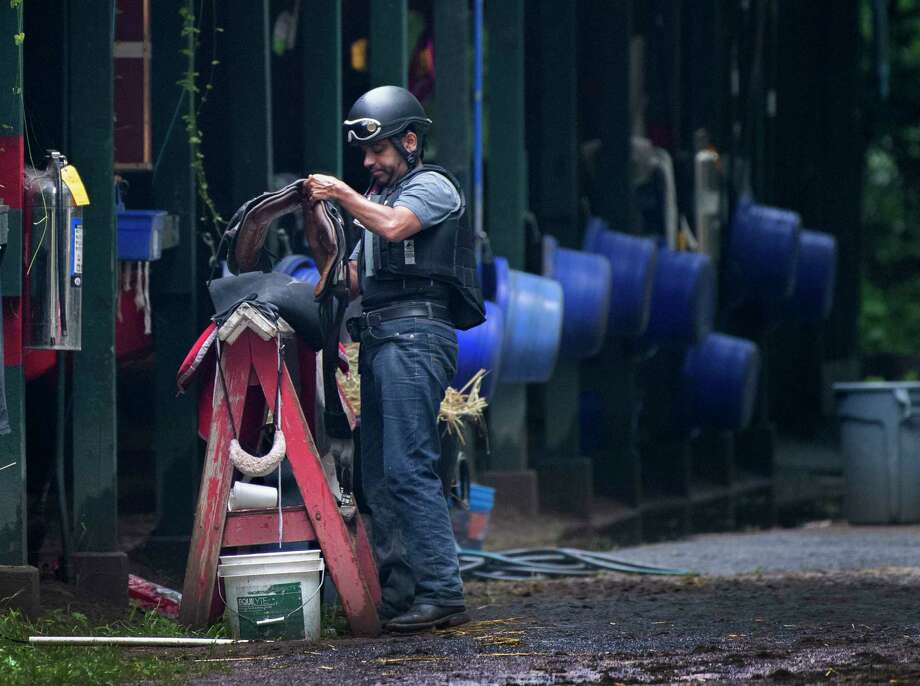 At the end of training hours rider Louis Peretta cleans his tack in the barn area of trainer Pat Kelly at the Saratoga Race Course Wednesday July 17 2019 in Saratoga Springs, N.Y.  Special to the Times Union by Skip Dickstein Photo: SKIP DICKSTEIN / ©Skip Dickstein 2019