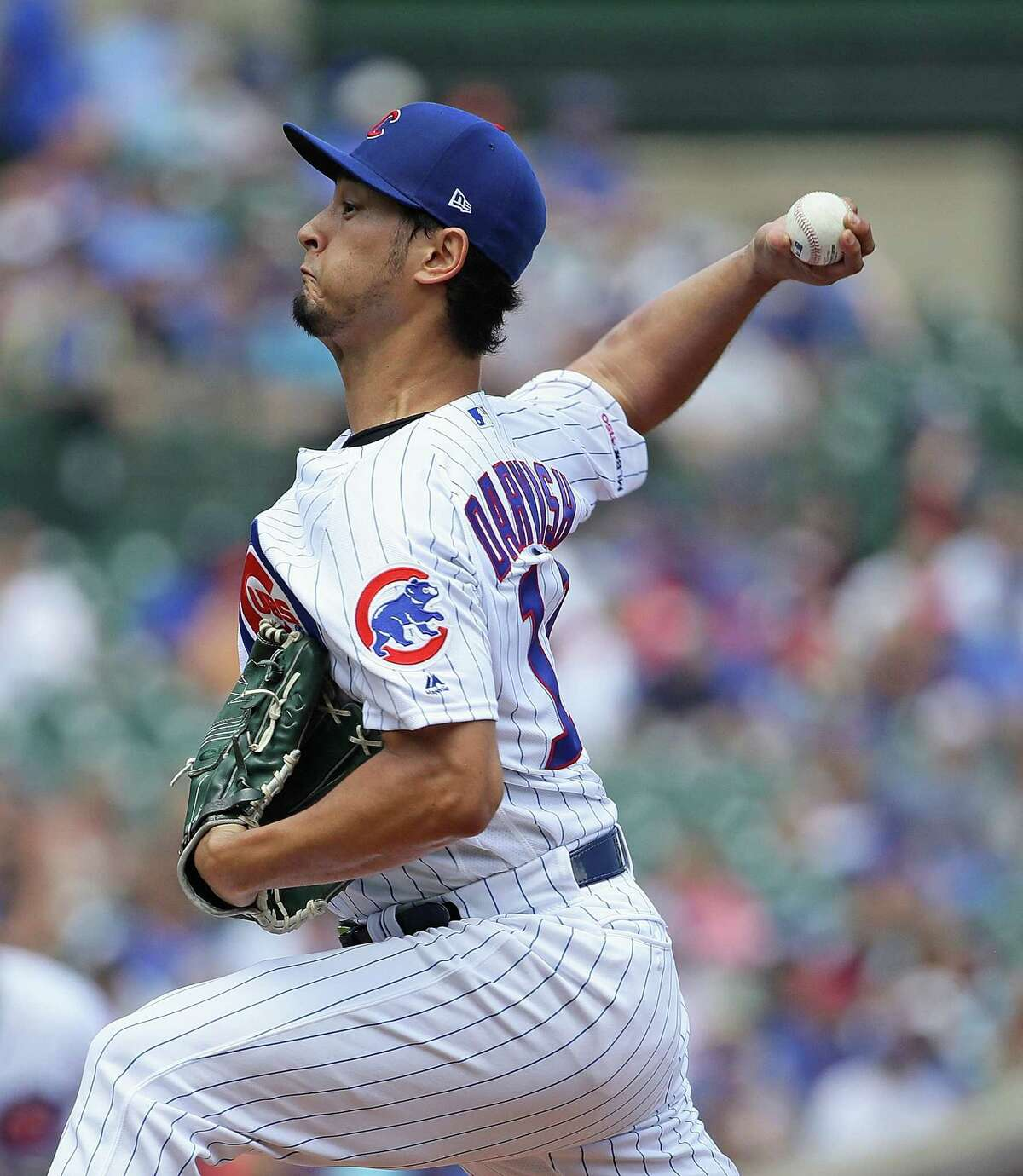 CHICAGO, ILLINOIS - JULY 17: Starting pitcher Yu Darvish #11 of the Chicago Cubs delivers the ball against the Cincinnati Reds at Wrigley Field on July 17, 2019 in Chicago, Illinois. (Photo by Jonathan Daniel/Getty Images)