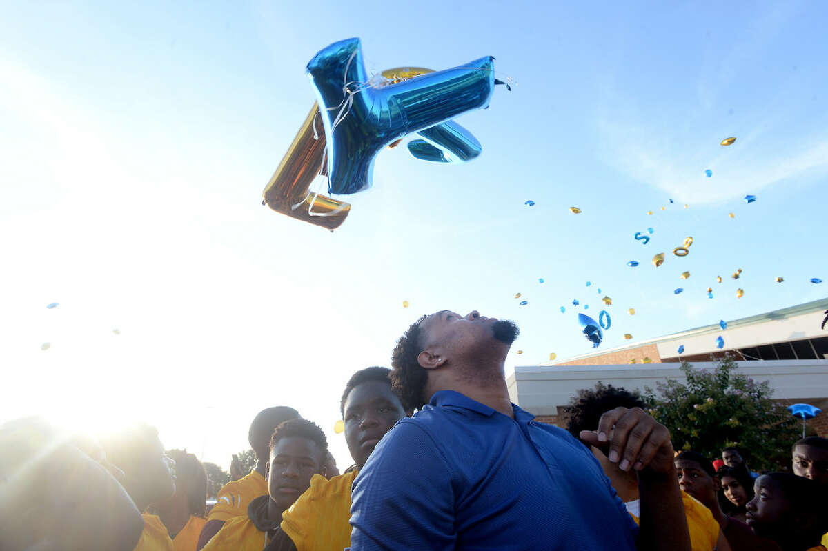 Deondre Moore, a 2013 Ozen graduate who played under Ed Taylor, watches the sky as he and others gather for a balloon release during the memorial service for Ed Taylor, a former Ozen football head coach and assistant coach for Beaumont United at United James F. Jackson Center for the Performing Arts Wednesday. Taylor passed away last weekend. Photo taken Wednesday, July 17, 2019 Kim Brent/The Enterprise
