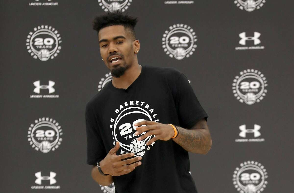 Warriors guard Jacob Evans makes a surprise visit to Warriors Basketball Camp in the gym at San Mateo High School on Wednesday, July 17, 2019 in San Mateo, Calif.