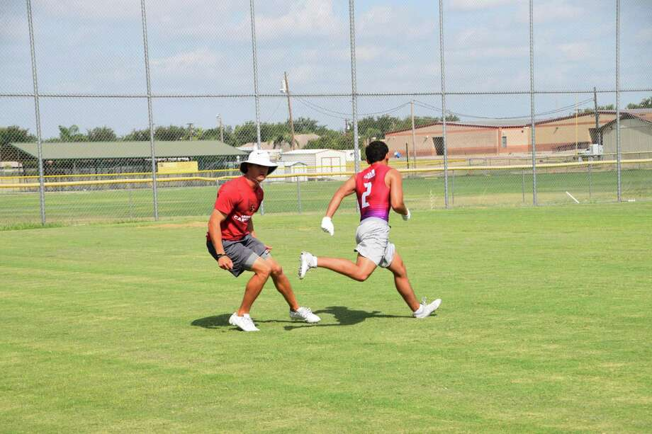 Former Texas receiver Jaxon Shipley held a workout with some of the Alexander skill position players Wednesday at the Bulldogs' practice field. Photo: Chris Jackson /Laredo Morning Times
