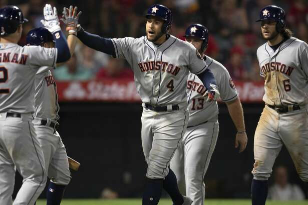Houston Astros' George Springer, center, celebrates his three-run home run with his teammates in a baseball game against the Los Angeles Angels in Anaheim, Calif., Wednesday, July 17, 2019. (AP Photo/Kyusung Gong)