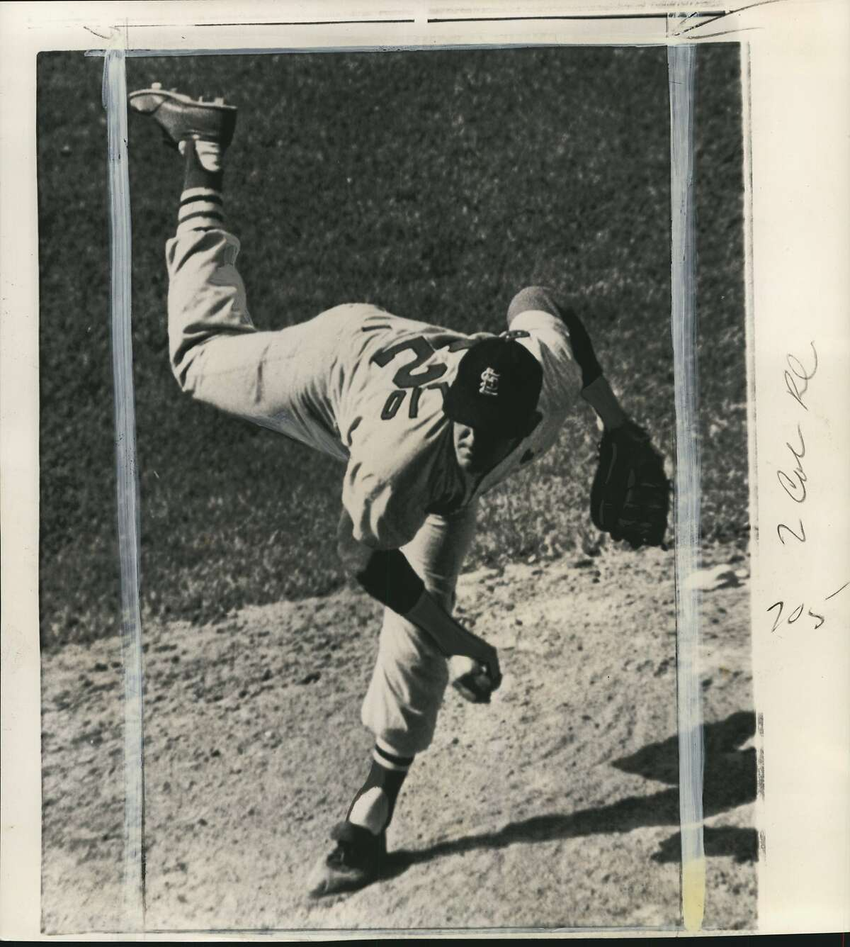 Broglio, Ernie (Baseball). Ernie Broglio of the St. Louis Cardinals lifts one leg high as he lets go a pitch against the Chicago Cubs while turning in his fifth shutout of the season Thursday in defeating the Windy City nine 1-0. Only one Cub got to second base.